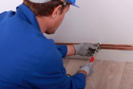 Citrus Heights plumbing professional works on copper pipes