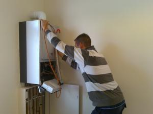 Water heater repair specialist in Citrus Heights works on a tankless